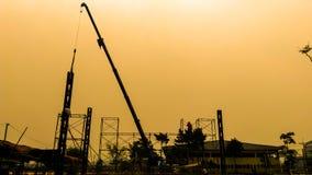 Schattenbild des Standortbauhintergrundes Stockfoto