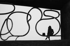 Schattenbild einer Sitzfrau Stockbilder