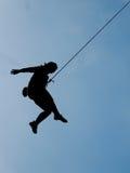 Schattenbild eines Bergsteigers Stockbilder