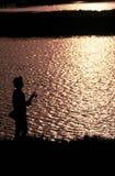 Schattenbild eines Fischers Lizenzfreies Stockbild