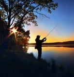 Schattenbild eines Fischers Lizenzfreie Stockfotografie