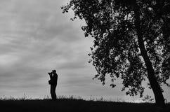 Schattenbild eines Fotografen Stockbilder