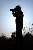 Schattenbild eines Fotografen Stockfotografie
