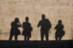 Schattenbild eines Fotografen in der alten Stadt Lizenzfreies Stockbild