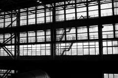 Schattenbild eines industriellen Teildienstes Stockbild