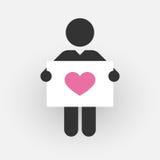 Schattenbild eines Mannes mit einem Zeichen mit rosa Herzen Stockbilder