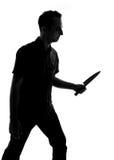 Schattenbild eines Mannes mit Messer Lizenzfreie Stockfotografie