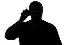 Schattenbild eines Mannes mit Symbol des Apfeltelefons Stockbild