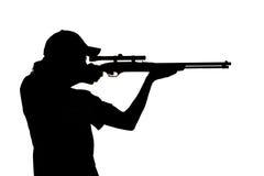 Schattenbild eines Schießens des jungen Mannes Stockfotografie