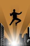 Schattenbild eines springenden Mannes Stockbilder