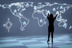 Schattenbild-Frau globales Real Estate stockfotos