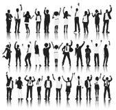 Schattenbild-Gruppe von Personenen-Stellung und Feier Stockfotos