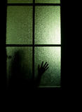 Schattenbild hinter einer Tür lizenzfreies stockfoto