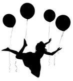Schattenbild-Mädchen-Kind-Reiten Baloons stockfoto