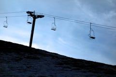 Schattenbild-Sesselbahn Stockbild