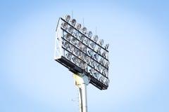 Schattenbild-Stadions-Flutlicht Stockfotos