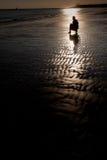 Schattenbild am Strand Stockfotografie
