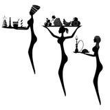 Schattenbild von drei Frauen mit Behältern, auf denen es Früchte gibt, Stockfotos