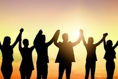 Schattenbild von Geschäftsleuten team und erfolgreiche Teamwork-Berühmtheit stockfoto