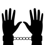 Schattenbild von Händen in den Handschellen Lizenzfreie Stockfotos