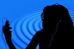 Schattenbild von jugendlich mit Digital-Video-Player Lizenzfreie Stockfotos