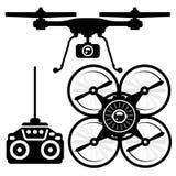 Schattenbild von quadcopter und von Fernbedienung Lizenzfreie Stockfotografie