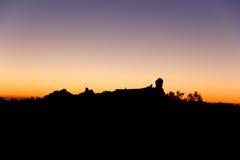 Schattenbild von Roque Nublo, Gran Canaria bei Sonnenuntergang Stockfoto