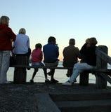 Schattenbild von sieben Leuten Lizenzfreie Stockbilder