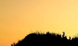 Schattenbild wenn Sonnenaufgang Lizenzfreie Stockfotos