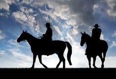 Schattenbildcowboys Lizenzfreie Stockfotos