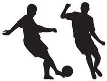 Schattenbilder der Fußballspieler Stockbild
