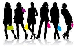 Schattenbilder der Mädchen mit farbigen Handtaschen