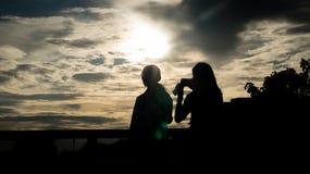 Schattenbilder der Männer und der Frauen Stockbild