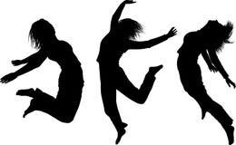 Schattenbilder der springenden Mädchen Lizenzfreies Stockfoto
