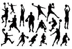 Schattenbilder des Basketball-Spieler-Vektors Lizenzfreie Stockfotos