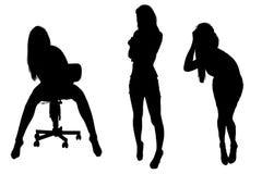 Schattenbilder von drei Mädchen Lizenzfreie Stockfotografie