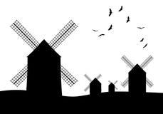 Schattenbilder von typischen spanischen Windmühlen und von Vögeln auf weißem Hintergrund Stockbilder