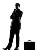 SchattenbildGeschäftsmann-Fluglagendenken nachdenklich Stockbild
