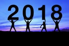 Schattenbildleute glücklich für 2018 neues Jahr Stockfotografie