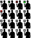 Schattenbildmann, der Platte mit verschiedenen Zeichen hält Stockfoto