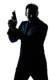 Schattenbildmannportrait mit Gewehr Stockfotografie
