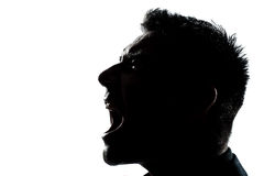 Schattenbildmannportrait-Profilschreien verärgert Lizenzfreies Stockfoto