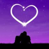 Schattenbildpaare, die Herz betrachten Stockfotografie