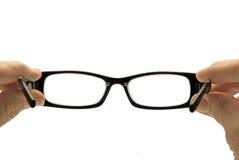 Schauen durch Brillen Stockfotos