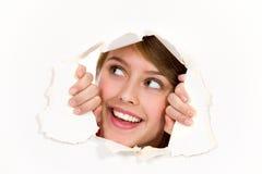 Schauen durch Papierloch Lizenzfreie Stockbilder