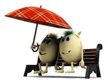 Schauen Sie auf glücklichen Marionetten unter großem Regenschirm Lizenzfreies Stockfoto