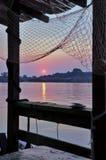 Sonnenuntergang und Fischernetz Lizenzfreies Stockfoto