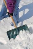 Schaufeln des Schnees Lizenzfreie Stockfotos