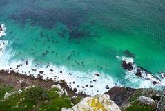 Schaukeln Sie Gesicht in das Meer Stockfotografie