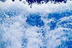 Schaumiger Wasserspritzen-Zusammenfassungshintergrund Stockfotografie
